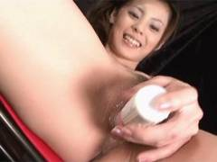 Sexy Natsumi stuffs a vibrator around her snatch